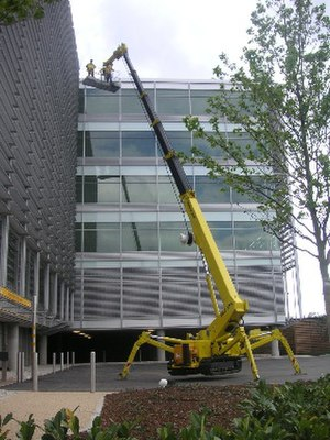 "Aerial work platform - ""Spider"" set up outside a building."