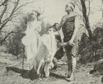 The Absentee (1915 film) - The characters, from left to right: Justice, Might (kneeling), and Success