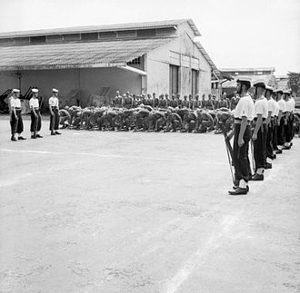 First Indochina War - Japanese troops lay down their arms to British troops in a ceremony in Saigon (1945).