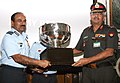 The Chairman Chiefs of Staff Committee (COSC) and Chief of Air Staff, Air Chief Marshal Arup Raha presenting the Defence Services Overall Championship Trophy to Lt. Gen. Jaiprakash Nehra of Army Red Team, in New Delhi.jpg