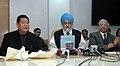 "The Deputy Chairman, Planning Commission, Shri Montek Singh Ahluwalia and the Chief Minister of Arunachal Pradesh, Shri Dorjee Khandu at the release of the ""State Development Report of Arunachal Pradesh"".jpg"