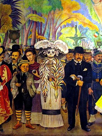 Detail of the 1947 Rivera mural, Dream of a Sunday Afternoon in the Alameda Central. The mural includes a depiction of La Catrina, a popular satirical character that has become associated with Dia de Muertos. The Kid - Diego Rivera.jpg