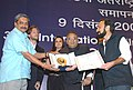 The Minister for Information & Broadcasting and Culture, Shri S. Jaipal Reddy presenting the Golden Peacock Award for the best film by an Asian Director to Mr. Asghar Farhadi.jpg