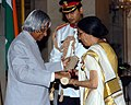 The President, Dr. A.P.J. Abdul Kalam presenting Padma Shri to well known Punjabi Fiction Writer, Smt. Ajeet Cour, at investiture ceremony in New Delhi on March 29, 2006.jpg