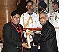 The President, Shri Pranab Mukherjee presenting the Padma Shri Award to Dr. Sunil Jogi, at a Civil Investiture Ceremony, at Rashtrapati Bhavan, in New Delhi on April 08, 2015.jpg