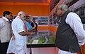 The Prime Minister, Shri Narendra Modi watching an exhibition on the Dhola-Sadia Bridge, across River Brahmaputra, in Assam.jpg
