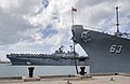 The amphibious assault ship USS Boxer (LHD 4), background, passes the Battleship Missouri Memorial as it arrives at Joint Base Pearl Harbor-Hickam, Hawaii, April 15, 2014 140415-N-WF272-005.jpg