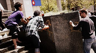 2011 Vancouver Stanley Cup riot - A group of volunteers clean spray paint off a wall