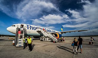 Jardines del Rey Airport - A Thomas Cook Airlines Airbus A330-200 boarding passengers