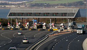 Toll road - A toll collection area  in the United Kingdom.