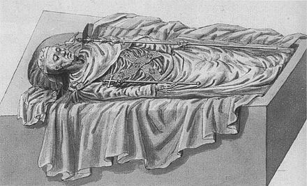 Remains of Edward I, from an illustration made when his tomb was opened in 1774 Tomb of Edward.jpg