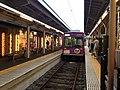 Train of Keifuku Electric Railroad and platform of Arashiyama Station.JPG
