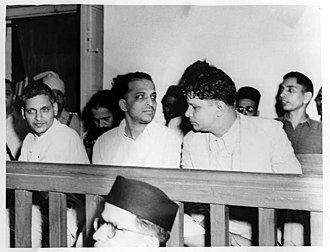Assassination of Mahatma Gandhi - The trial of persons accused of participation and complicity in the assassination at the Special Court in Red Fort Delhi on 27 May 1948. Left to right front row: Nathuram Godse, Narayan Apte and Vishnu Ramkrishna Karkar. Seated behind are (from left to right) Diganber Ram Chandra Badge, Shankar, Vinayak Savarkar, Gopal Godse and Dattatraya Sadashiv Parachure.