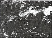 Satellite image of a poorly defined, dissipating tropical cyclone over North Carolina. The image shows a large portion of the United States east of the Rockies and part of Mexico as well as southern Canada. Another, better defined cyclone is visible on the right side of the image.