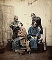 Two Japanese barbers; to the left, one is shaving his client Wellcome V0029727.jpg