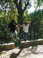 Two men jumping in a wooded area.jpg