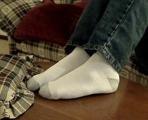 English: Socks on feet.