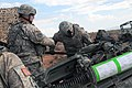 U.S. Army Sgt. Steven Mills, team chief with Section 6, Bravo Battery, 4th Battalion, 1st Field Artillery Regiment, 3rd Infantry Brigade Combat Team, 1st Armored Division ensures his Soldiers are following 130712-A-YG311-005.jpg