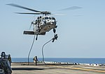 U.S. Marines assigned to the 31st Marine Expeditionary Unit fast-rope from an MH-60S Seahawk helicopter to the flight deck of the amphibious assault ship USS Bonhomme Richard (LHD 6) during a training exercise 130901-N-KE519-004.jpg