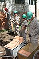 U.S. Marines with the 9th Engineer Support Battalion and a Soldier with the 96th Troop Command pass bricks during renovation work at Erdmiin Oyun High School in Nalaikh district, Ulaanbaatar, Mongolia, July 21 130721-M-DR618-100.jpg
