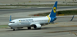 Transport in Ukraine - A Boeing 737 of UIA, one of Ukraine's flag carriers, taxiing at Barcelona (El Prat) Airport