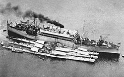 USS Argonne (AS-10) at anchor, with USS Bass (SS-164), USS Barracuda (SS-163) and USS Bonita (SS-165) alongside, in 1927-1928 (NH 61683)
