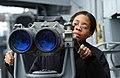 "US Navy 021206-N-1328C-501 Signalman 3rd Class Tiffany Culereth from Bronx, N.Y., observes ships in the area through binoculars called ""Big Eyes."".jpg"