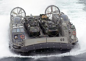 Invasion - An LCAC carrying LAVs ashore during the 2003 invasion of Iraq