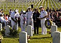 US Navy 030911-N-9593R-005 Navy personnel pause for a moment with a family member after laying flowers at a grave marker in Arlington National Cemetery.jpg