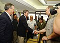 US Navy 031014-N-4374S-001 Ambassador L. Paul Bremer III, Administrator of the Coalition Provisional Authority in Iraq, greets the owner of Al-Mathaly Computer Store with U.S. Secretary of Commerce Donald Evans.jpg