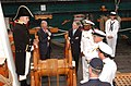 US Navy 040625-N-2568S-002 Secretary of the Navy, Gordon R. England and British Ambassador, Sir David Manning listen as USS Constitution, Executive Officer, Lt. William Marks describes life aboard Constitution in the early 1800.jpg