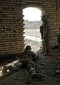 US Navy 041129-M-0000F-003 U.S. Navy Chaplain, Lt. Kenny Lee, right, looks out on the city of Fallujah, Iraq, while Marines assigned to 3rd Charlie Company, 1st Battalion, 3rd Marine Regiment, keep a watch on the city's.jpg