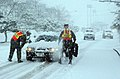 US Navy 041231-N-9849W-002 Security personnel make sure drivers exercise caution on both on board Naval Air Facility Atsugi, Japan, after a snow storm hit the area.jpg