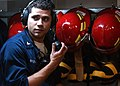 US Navy 050118-N-9183C-215 Personnelman 3rd Class Robert Rivera of Bronx, N.Y., tests sound powered telephones in a damage control repair locker aboard USS Ronald Reagan (CVN 76) prior to a general quarters (GQ) drill.jpg