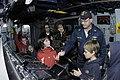 US Navy 051013-N-6477M-130 Children from the Fairmount Elementary School in Mukilteo, Wash., learn how to man the helm.jpg