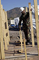 US Navy 051113-F-2729L-013 U.S. Navy Chief Equipment Operator Derrick Arrington, assigned to Naval Mobile Construction Battalion Seven Four (NMCB-74), points out field latrines that his team constructed.jpg
