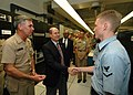 US Navy 060822-N-4965F-002 Secretary of the Navy (SECNAV), the Honorable Dr. Donald C. Winter, greets Information Systems Technician 3rd Class Brent Jackson from Oakdale, Calif., during a visit to Naval Computer and Telecommuni.jpg