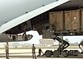 US Navy 060831-N-3560G-052 Members of Naval Mobile Construction Battalion Four (NMCB-4) load Tricon Containers loaded with construction equipment destine for field testing in Iraq, into a U.S. Air Force, Air Mobility Command, C.jpg