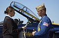US Navy 061025-N-5060B-100 Mass Communication Specialist Heather Ewton interviews Blue Angel's pilot Lt. Kevin Davis after giving a media ride to local VIP personnel prior to the 2006 Naval Air Station Jacksonville (NAS Jax) Sh.jpg