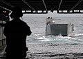 US Navy 061127-N-8197M-017 Landing Craft Utility (LCU) 1617 enters the well deck of amphibious assault ship USS Bonhomme Richard (LHD 6) during onload-offload operations off the coast of Southern California.jpg