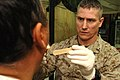 US Navy 061220-N-5758H-028 Lt. Cmdr Thomas Friedrich, assigned to the 1st Medical Battalion, Camp Pendleton, performs a medical evaluation on an Iraqi citizen.jpg