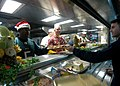 US Navy 061225-N-8146B-008 The amphibious assault ship USS Boxer's (LHD 4) commanding officer, Capt. Bruce Nichols, and executive officer, Capt. Matthew McCloskey, serve Christmas dinner to the crew.jpg