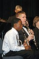 US Navy 070120-N-3957E-079 Chief Musician Michael M. Shelburne plays clarinet alongside a Randallstown High School student musician during a public concert given by the U.S. Navy Band at Randallstown High School.jpg