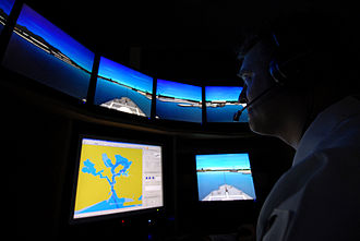 Helmsman - A ship bridge simulator with 3-D graphics creates scenarios with realistic sights and sounds to train mariners in ship handling.
