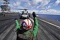 US Navy 070809-N-6326B-043 Aviation Structural Mechanic Airman Joshua Dowdy prepares an SH-60F Seahawk helicopter, assigned to the Indians of Helicopter Anti-Submarine Squadron (HS) 6, for take off on the flight deck.jpg