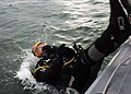 US Navy 071024-N-9621S-003 Navy Diver 1st Class Troy Jones makes a splash as he enters the water to oversee MK-16 MOD 1 dive training being held at Explosive Ordnance Disposal Training and Evaluation Unit (EODTEU) 2.jpg