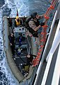 US Navy 071202-N-2838W-050 Members of the guided-missile destroyer USS Bulkeley's (DDG 84) visit, boarding, search and seizure team climb aboard training support vessel Prevail (TSV 1) for a simulated real-life boarding.jpg