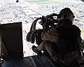 US Navy 071211-M-6020M-005 U.S. Marine Cpl. Corey Fellenzer, a crew chief with Marine Heavy Helicopter Squadron (HMH) 462, surveys the area while manning a 50-caliber machine gun.jpg