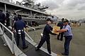 US Navy 090219-N-7280V-073 A Sailor assigned to the amphibious command ship USS Blue Ridge (LCC 19) passes a box of books to a member of the Armed Forces of the Philippines Navy.jpg