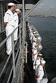 US Navy 090317-N-1688B-015 Sailors aboard the amphibious transport dock ship USS Nashville (LPD 13) salute the Nigerian Navy frigate NNS Aradu (F 89) while pulling into Lagos Nigeria.jpg